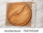 pizza board and canvas napkin... | Shutterstock . vector #703745269