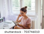 giving the project her full... | Shutterstock . vector #703746010