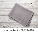 napkin on table in perspective... | Shutterstock . vector #703746439