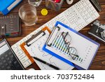 business accounting  | Shutterstock . vector #703752484