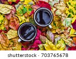 autumn time. two cups of black... | Shutterstock . vector #703765678
