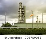 industrial view at oil refinery ... | Shutterstock . vector #703769053