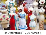Small photo of Colorful mannequins as souvenirs or hangers for small items decorated as retro dresses, nice item for home design