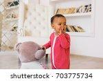 happy mixed race toddler boy   Shutterstock . vector #703775734