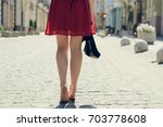 elegant pretty woman with shoes ... | Shutterstock . vector #703778608
