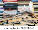 a stack of books with colorful... | Shutterstock . vector #703788040