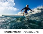 muscular surfer with long white ... | Shutterstock . vector #703802278