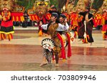 Small photo of Jakarta, Indonesia - April 23, 2017 : The dance performance using a horse board is called Kuda Lumping in Jakarta, Indonesia.