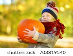 adorable little girl having fun ... | Shutterstock . vector #703819540