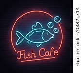 fish cafe neon sign  bright... | Shutterstock .eps vector #703825714