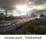 road traffic in city at... | Shutterstock . vector #703826068
