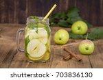 dietary detox drink with apple... | Shutterstock . vector #703836130