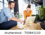 happy work colleagues working... | Shutterstock . vector #703841110