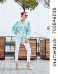 fashion model brunette woman...   Shutterstock . vector #703846018