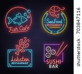 set neon sign theme sea food.... | Shutterstock .eps vector #703847116