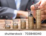 midsection of businessman... | Shutterstock . vector #703848340