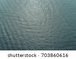 water surface background from... | Shutterstock . vector #703860616