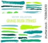 vector paint brush spots ... | Shutterstock .eps vector #703865650
