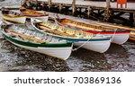 canoes in mystic seaport  ct | Shutterstock . vector #703869136