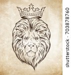 hand drawn crowned lion head... | Shutterstock .eps vector #703878760