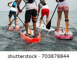 Small photo of Stand up paddle group on the sea