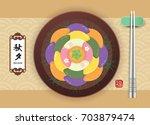 chuseok or hangawi   korean... | Shutterstock .eps vector #703879474