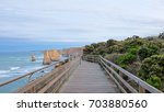 Small photo of Beautiful view of the great ocean road on the walk way beside the sea during sunrise with cloudy