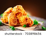 fried chicken wings and legs on ... | Shutterstock . vector #703898656