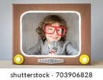 child playing with cardboard... | Shutterstock . vector #703906828