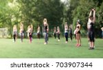 group yoga on the street | Shutterstock . vector #703907344