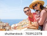 tourists looking at scenic view ...   Shutterstock . vector #703912378