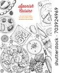 spanish cuisine top view frame. ... | Shutterstock .eps vector #703924969