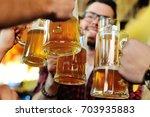 friends clink glasses of beer...   Shutterstock . vector #703935883