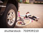accident. small girl on the... | Shutterstock . vector #703939210