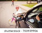 accident. small girl on the... | Shutterstock . vector #703939906
