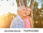 senior man with his... | Shutterstock . vector #703943380