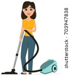 housewife vacuuming home with a ... | Shutterstock .eps vector #703947838