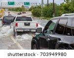 houston  texas   august 27 ... | Shutterstock . vector #703949980