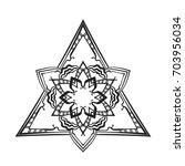 round flower mandala in...   Shutterstock .eps vector #703956034