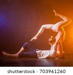 acrobatic number. two acrobats. | Shutterstock . vector #703961260