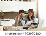 depressed young caucasian...   Shutterstock . vector #703970800