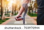 injured man trying to walk on ... | Shutterstock . vector #703970944