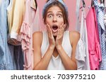 adorable woman looking with... | Shutterstock . vector #703975210