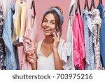 lovely female wearing scarf on...   Shutterstock . vector #703975216