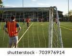 goalkeeper watching game as his ... | Shutterstock . vector #703976914