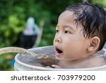 children play and bathed water... | Shutterstock . vector #703979200