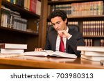 man reading a lot of books in... | Shutterstock . vector #703980313