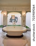 Small photo of UDAIPUR, INDIA - JANUARY 21, 2017: Bathroom at the Oberoi Udaivilas Hotel suite. Located on the bank of Lake Pichola the hotel has over fifty acres, which includes a twenty-acre wildlife sanctuary.
