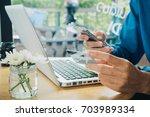 hipster man hands holding a... | Shutterstock . vector #703989334