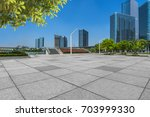 empty pavement and modern... | Shutterstock . vector #703999330
